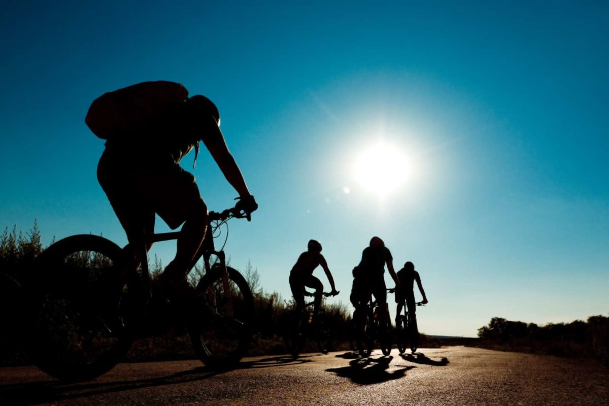 9524666 - group of cyclists biking in motion